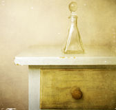 Perfume bottle on dresser Stock Images