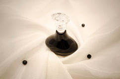 Perfume bottle on fabric Royalty Free Stock Image