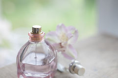 Perfume bottle with floral water Royalty Free Stock Photography