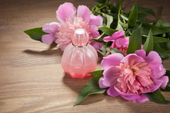 Perfume bottle and flowers on old boards Royalty Free Stock Images