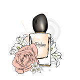 Perfume bottle and flowers. Royalty Free Stock Photo