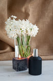Perfume bottle with flowers Stock Photos