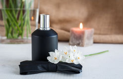 Perfume bottle with flowers Stock Photography