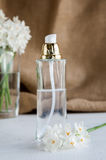 Perfume bottle with flowers Stock Images