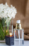 Perfume bottle with flowers Stock Photo