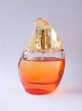 Perfume bottle. Fragrance aroma orange essential oils scent bouquet redolence glass odour whiff savor savour cosmetic Stock Images