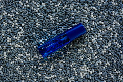 Perfume bottle on a gravel Royalty Free Stock Images