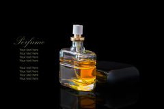 Perfume bottle isolated on black background with reflexion. The file includes a clipping path so it is easy to work.  Sample text Stock Photos