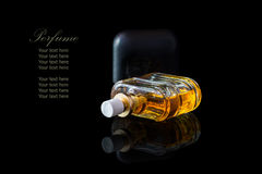 Perfume bottle isolated on black background with reflexion. The file includes a clipping path so it is easy to work.  Sample text Stock Photo