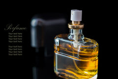 Perfume bottle isolated on black background with reflexion. The file includes a clipping path so it is easy to work.  Sample text Stock Images