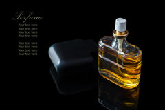 Perfume bottle isolated on black background with reflexion. The file includes a clipping path so it is easy to work.  Sample text Royalty Free Stock Photos