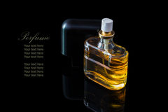 Perfume bottle isolated on black background with reflexion. The file includes a clipping path so it is easy to work.  Sample text Stock Image