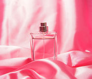 Perfume bottle isolated on pink Stock Photos