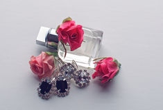 Perfume bottle and jewelry set Royalty Free Stock Images