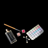 Perfume bottle, makeup brushes, make-up eye shadows palette and lipsticks. Fashion woman still life. Pop female things. On black background. Beauty tools, free Royalty Free Stock Images