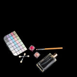 Perfume bottle, makeup brushes, make-up eye shadows palette and lipsticks. Fashion woman still life. Pop female things. On black background. Beauty tools, free Royalty Free Stock Image
