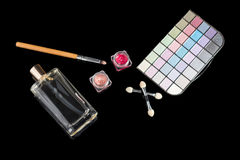 Perfume bottle, makeup brushes, make-up eye shadows palette and lipsticks. Fashion woman still life. Pop female things. Perfume bottle, makeup brush, make-up eye Royalty Free Stock Photo