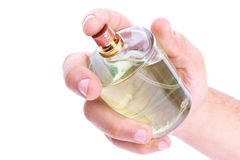 Perfume bottle. Male hand holding a perfume bottle isolated on white background Stock Photos