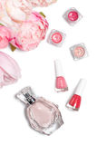 Perfume bottle, nail polish, lipstick. Fashion woman still life. Pop female things with flowers on white background. Perfume bottle, nail polish, lipstick Stock Photos
