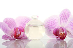 Perfume bottle and orchids Stock Photo