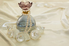 Perfume bottle and pearls 2 Royalty Free Stock Image
