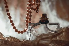 Perfume bottle with pearls Stock Photography