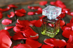 Perfume bottle and petals Royalty Free Stock Photos