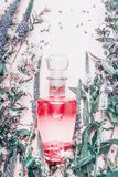 Perfume bottle with plants and flowers, top view. Perfumery, cosmetics, botanical fragrance. Concept royalty free stock image