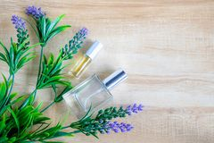 Perfume bottle and purple flower royalty free stock images