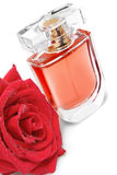 Perfume bottle and rose Royalty Free Stock Photo