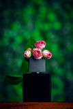 Perfume bottle with rose Stock Photo