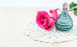 Perfume bottle with roses Royalty Free Stock Photo