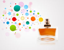 Perfume bottle spraying bubbles Stock Photos