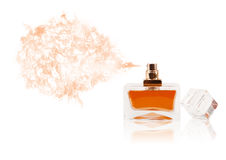 Perfume bottle spraying colored scent Royalty Free Stock Image