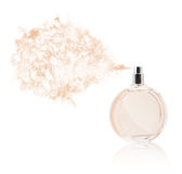 Perfume bottle spraying colored scent Stock Images