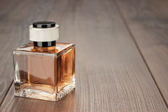 Perfume bottle on the table Stock Photo