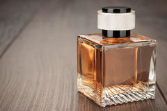 Perfume bottle on the table Royalty Free Stock Image