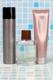 Perfume bottle on tile Royalty Free Stock Photography