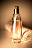 Perfume bottle and towel Royalty Free Stock Image