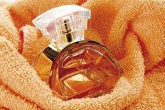 Perfume bottle on towel Stock Image