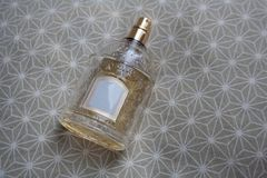 Perfume bottle with relief glass on beige tissue royalty free stock photo