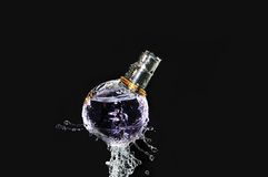 Perfume bottle on water Royalty Free Stock Photos