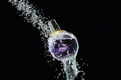 Perfume bottle on water Stock Images