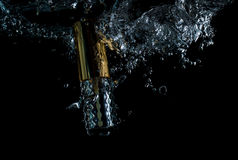Perfume bottle and water splash smartly, wave, macro,. Perfume bottle and water splash smartly, begun, wave, macro Royalty Free Stock Image
