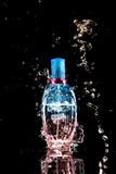 Perfume bottle with water splashes Stock Photos
