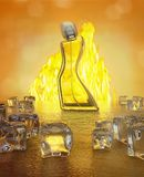 Perfume bottle on wooden background. Fire and ice. Stock Photo