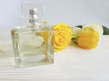 Perfume bottle product yellow rose on a wooden. Perfume bottle yellow rose on a wooden composition product Royalty Free Stock Photography