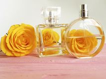 Perfume bottle yellow rose on a wooden decoration. Perfume bottle yellow rose on a wooden aromatherapy decoration Stock Photography