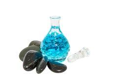 Perfume Bottle and Zen Stone I Royalty Free Stock Image