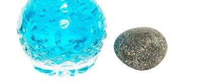 Perfume Bottle and Zen Stone V Royalty Free Stock Photo